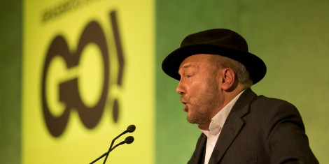 Unannounced mystery guest speaker British politician George Galloway makes a speech at a rally held by the Grassroots Out (GO), anti-EU campaign group at the Queen Elizabeth II conference centre in London, held to coincide with the EU summit in Brussels, Friday, Feb. 19, 2016. British Prime Minister David Cameron pushed a summit into overtime Friday after a second day of tense talks with weary European Union leaders unwilling to fully meet his demands for a less intrusive EU. (AP Photo/Matt Dunham)